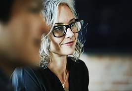 Talk to an NEA Retirement Specialist - Woman Listening at a Meeting