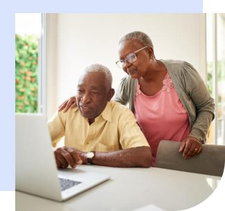 Elderly couple reading about social security online