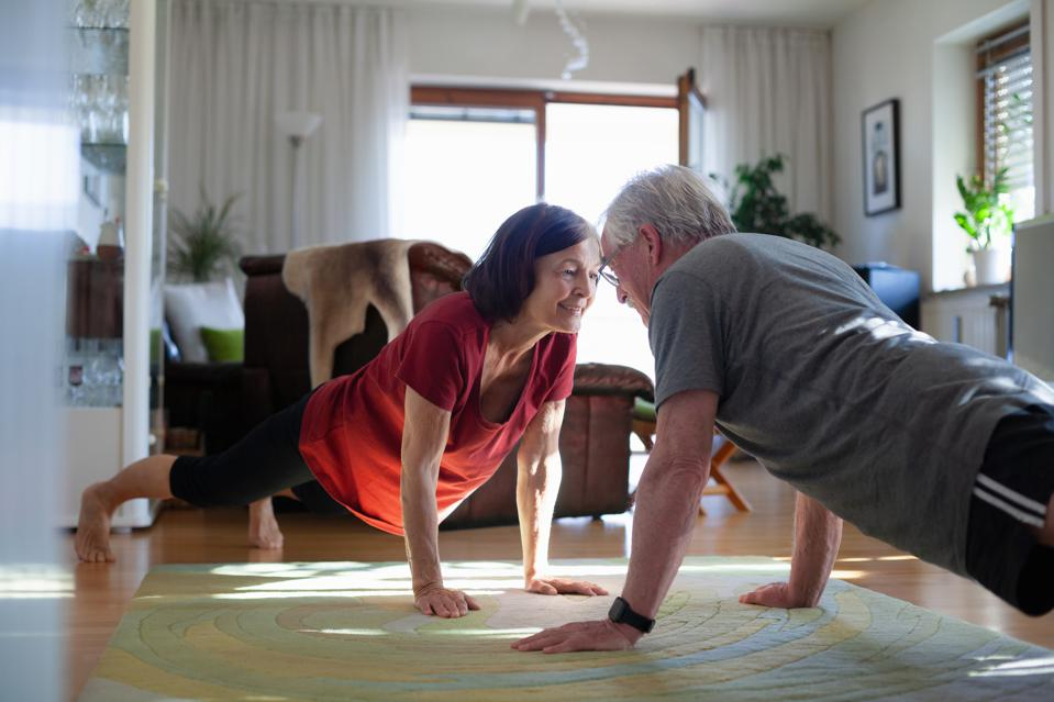 Senior couple exercising at home